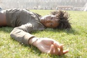 depositphotos_20082605-Attractive-young-black-woman-laying-down-on-green-grass-in-the-city-of-London-on-a-sunny-day